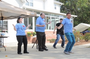 James Blakeney (back, second from left) showcases his VBS moves as longtime VBS songwriter Jeff Slaughter (front) leads the group in the Amazing Wonders Aviation theme song from 2012.