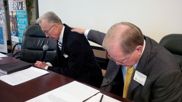 Alabama Baptist State Board of Missions Executive Director Rick Lance (left) prays about state marriage ruling alongside state convention president Travis Coleman Feb. 6.