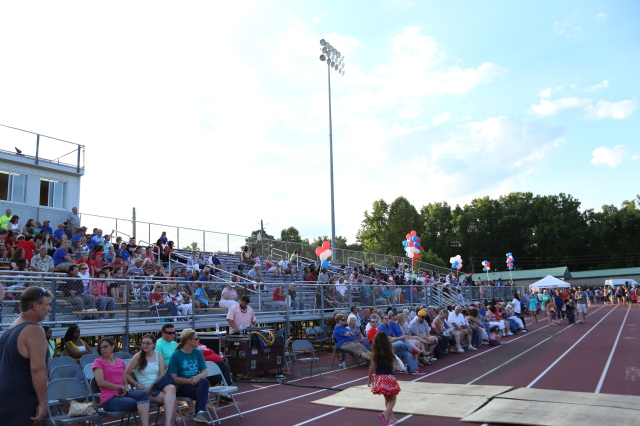 The stands at the Pleasant Grove Sports Complex begin to fill as community members gather at FBC Pleasant Grove's patriotic event.