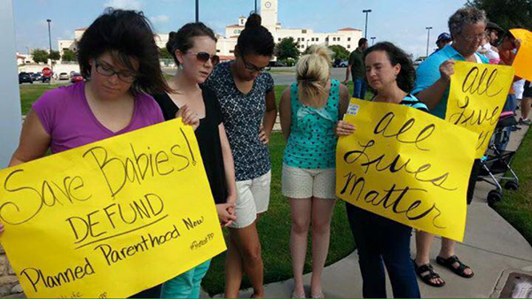 Nearly 600 protesters gathered at a Planned Parenthood clinic in Forth Worth, Texas,  on Aug. 22. Photo by Scott Colter