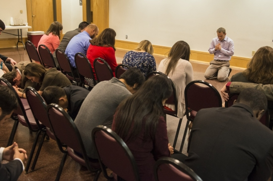 IMB President David Platt (right) spends time in prayer with IMB's newest missionaries prior to the Nov. 8 service at First Baptist Church, New Orleans. BP photo