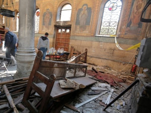 Egyptian security officials and investigators inspect the scene following a bombing inside Cairo's Coptic cathedral in Egypt December 11, 2016. REUTERS/Amr Abdallah Dalsh